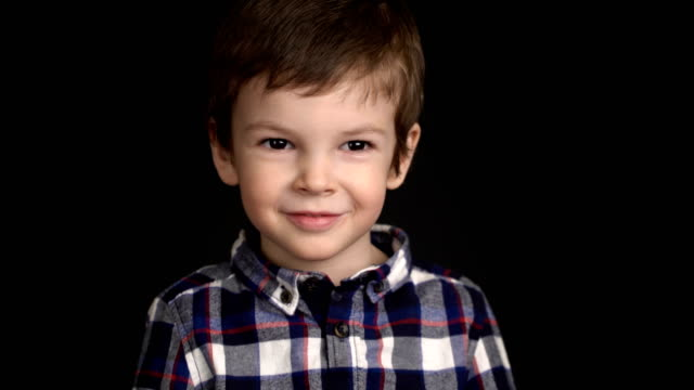portrait of little boy looking at camera - neonati maschi video stock e b–roll