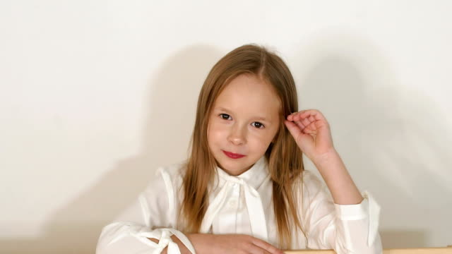 Portrait of little girl near the eco-bench in the Studio with a white background