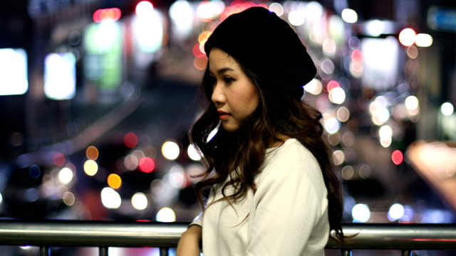 Portrait of lonely asian woman, outdoor in night video
