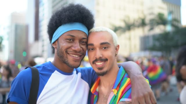 portrait of male couple during lgbtqi parade - couple portrait caucasian video stock e b–roll