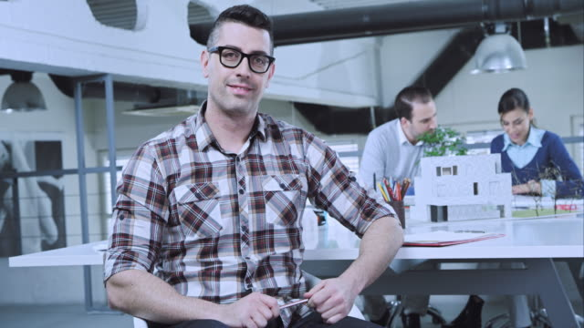 Portrait of male designer in the meeting room video