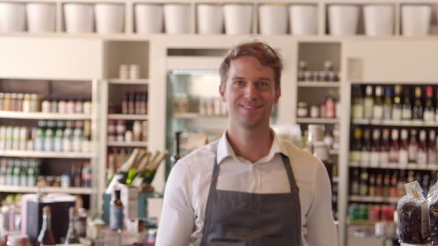 portrait of male employee in delicatessen shot on r3d - delis stock videos and b-roll footage