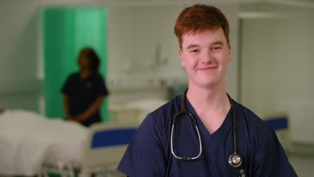 portrait of male medical worker - essential workers stock videos & royalty-free footage