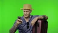 istock Portrait of man tourist with suitcase using mobile phone, chatting. Chroma key 1222117999