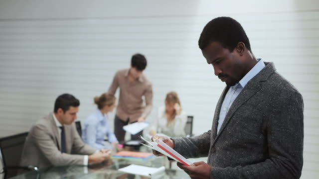 Portrait of man with business people in office meeting room video