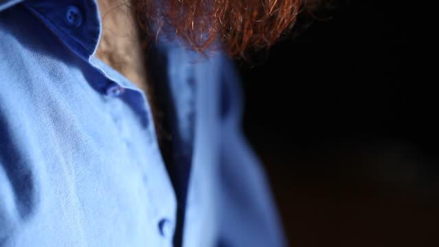 Portrait of man with red long beard, tilt up video video
