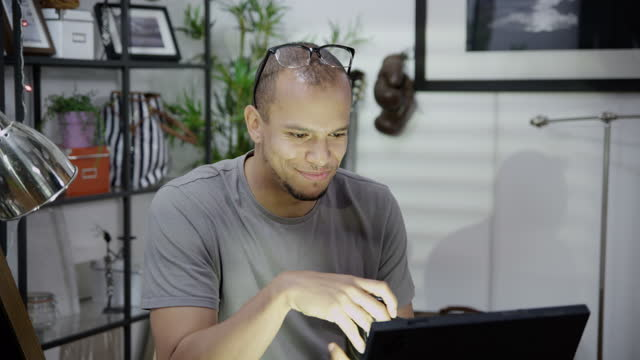 Portrait of man working from home video