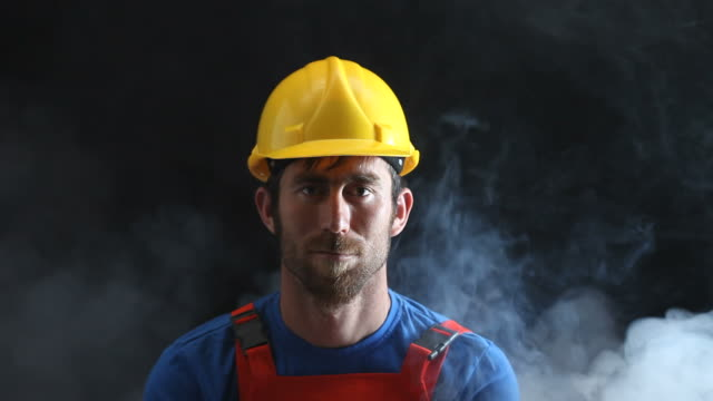 Portrait of Manual Worker In Dark And Fog video