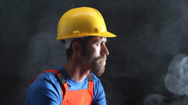 Portrait of Manual Worker Smoking In Dark video