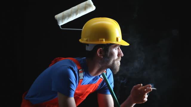 Portrait of Manual Worker Smoking In Dark video