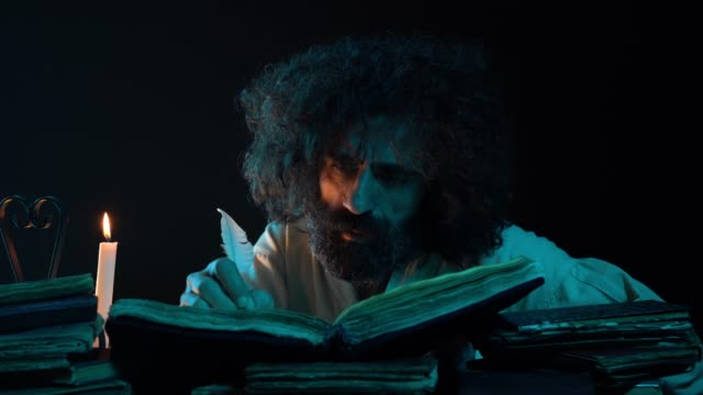 UHD Portrait Of Mature Adult Man Writing With Quills Pen