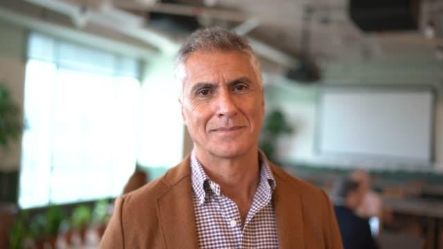 portrait of mature businessman at office - cinquantenne video stock e b–roll