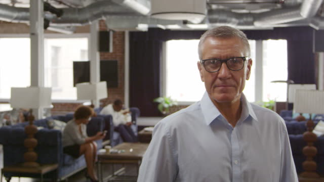 Portrait Of Mature Businessman In Office Shot On R3D - vídeo