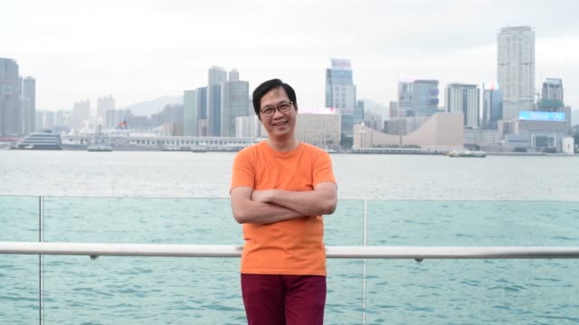 Portrait of mature Chinese man in Hong Kong smiling
