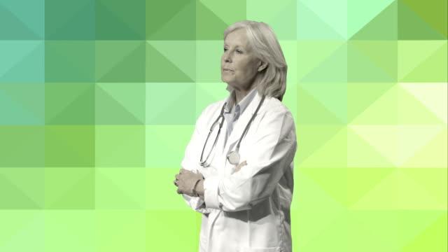 portrait of mature senior healthcare doctor - mature women studio grey hair bildbanksvideor och videomaterial från bakom kulisserna