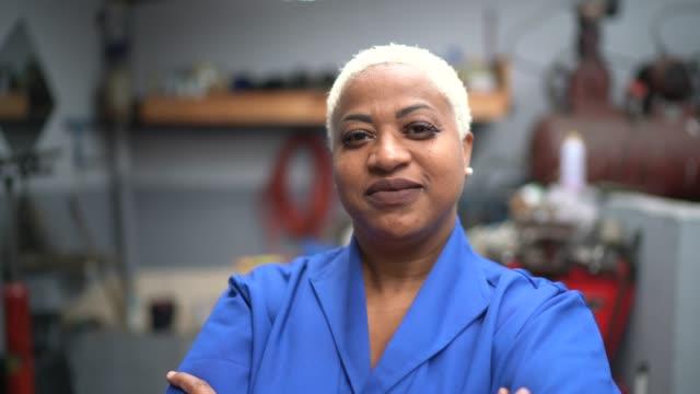 Portrait of mechanic woman in auto car repair