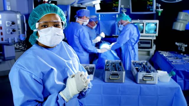 portrait of medical multi ethnic female observing team - guanto indumento sportivo protettivo video stock e b–roll