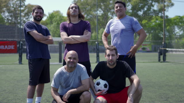 Portrait of mid adult men standing on soccer field before the game Portrait of five mid adult friends standing on soccer field before the game,looking at camera pre game stock videos & royalty-free footage
