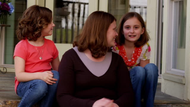 Portrait of mother and two daughters HD 1080p: Portrait of mother and two daughters porch stock videos & royalty-free footage
