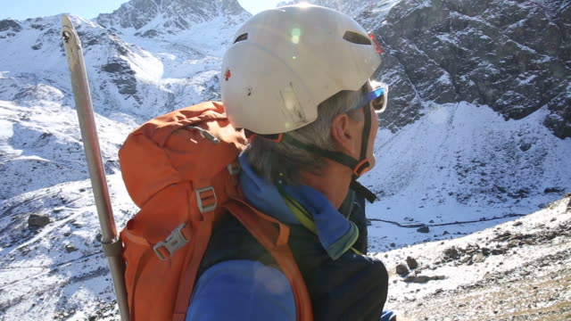 Portrait of mountaineer above valley, mtns  extreme terrain stock videos & royalty-free footage