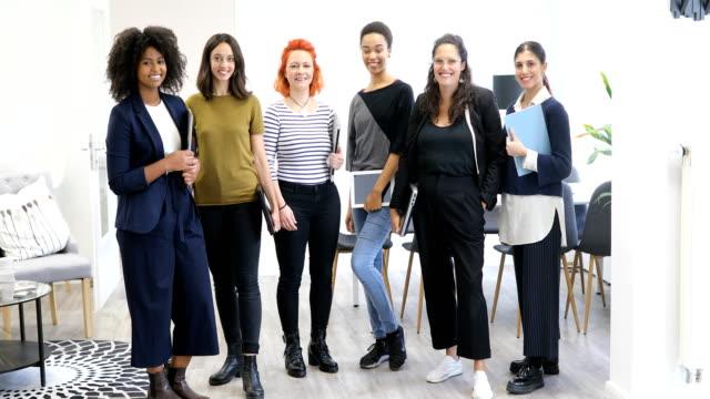 portrait of multi-ethnic smiling businesswomen - potere femminile video stock e b–roll