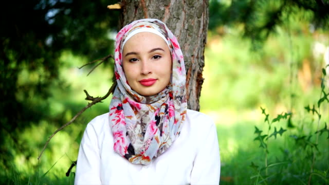 portrait of muslim girl against green nature - eid mubarak stock videos and b-roll footage