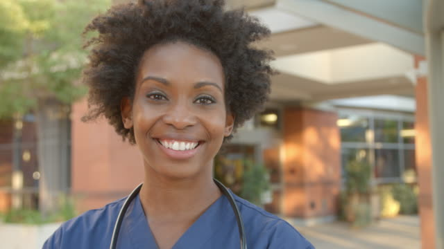 Portrait Of Nurse Standing Outside Hospital Shot On R3D Portrait Of Nurse Standing Outside Hospital Shot On R3D focus on foreground stock videos & royalty-free footage
