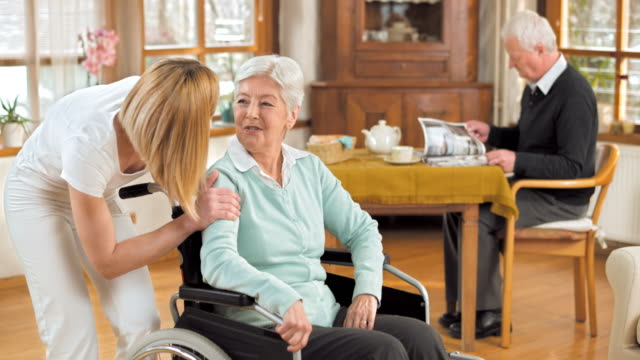 DS Portrait of nurse with senior woman in wheelchair video
