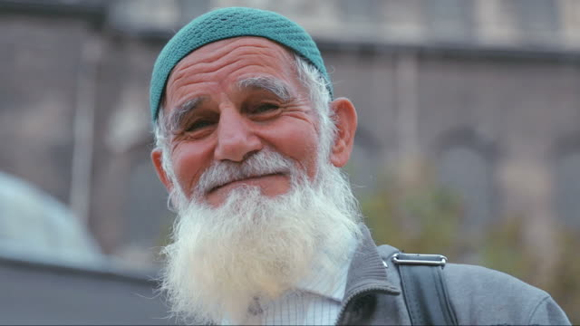 Portrait of old muslim man Portrait of old muslim man with beard. Looking at camera, smiling. turkey stock videos & royalty-free footage