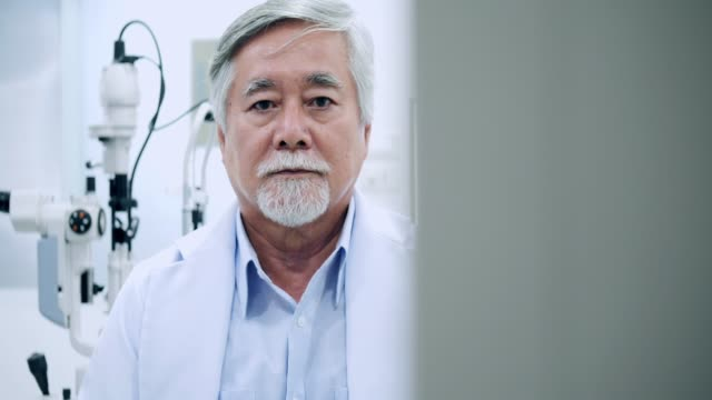 Portrait of older man at ophthalmological examination in consulting room Portrait of older man at ophthalmological examination in consulting room ophthalmologist stock videos & royalty-free footage