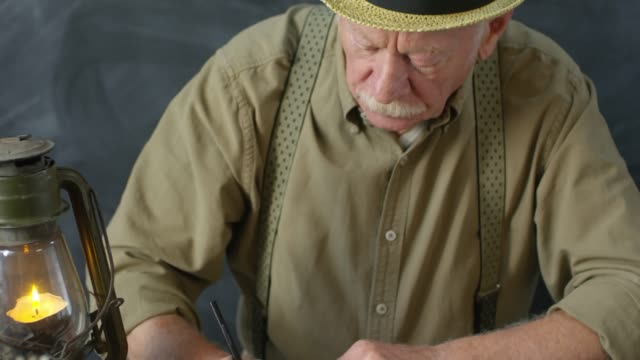 Portrait of Old-Fashioned Elderly Man Writing Poem