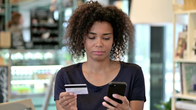 Portrait of Online Payment Failure on Smartphone by African Woman