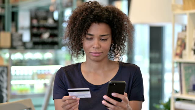Portrait of Online Payment on Smartphone by African Woman