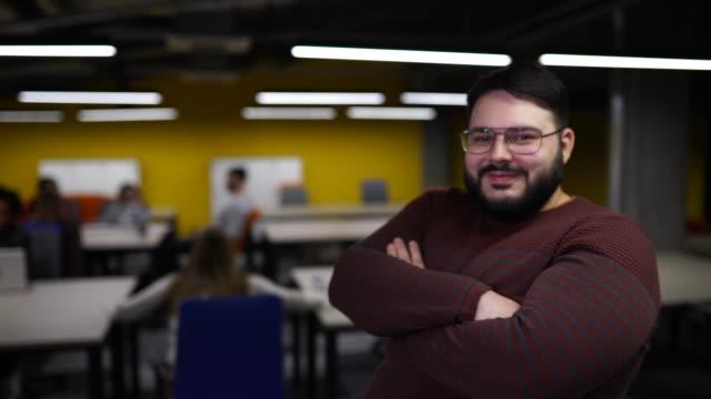 Portrait of overweight entrepreneur in modern office