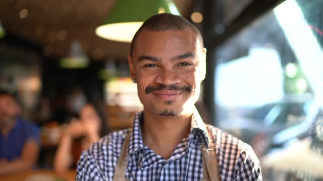 Portrait of Owner / Waiter at Restaurant Portrait of Owner / Waiter at Restaurant black people stock videos & royalty-free footage