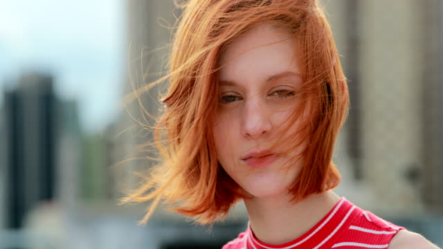 Portrait of pretty young casual woman looking to camera and smiling Red-hair