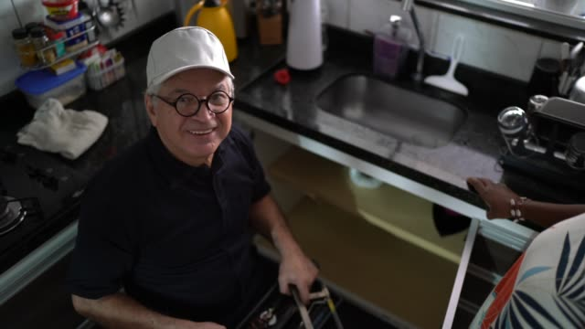 Portrait of repairman working at customer's home Portrait of repairman working at customer's home pipefitter videos stock videos & royalty-free footage