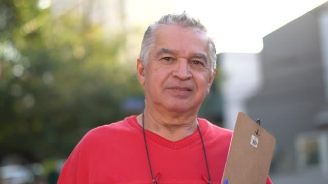 portrait of researcher senior man - латинская америка стоковые видео и кадры b-roll