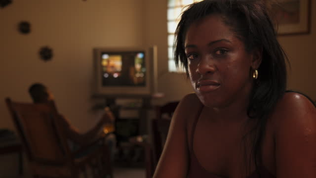 Portrait Of Sad Depressed Young Black Woman Crying At Home
