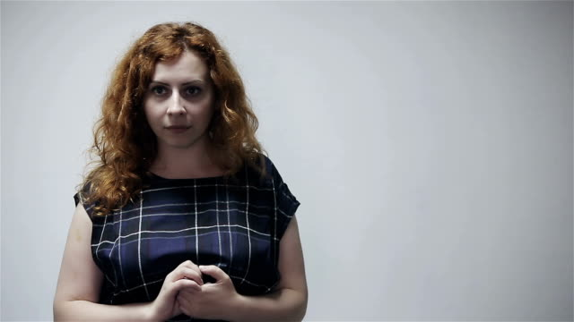 Portrait of sad woman at gray background video