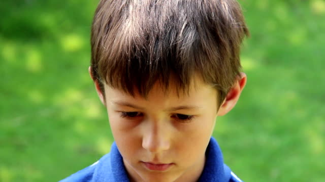 Portrait Of Sad Young Caucasian Boy Looking At Camera video