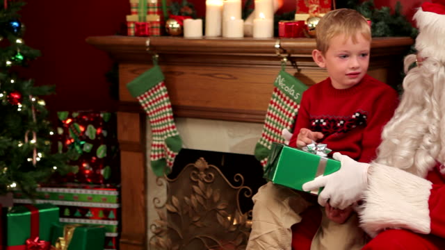 Portrait of Santa Claus and young boy  christmas stocking stock videos & royalty-free footage