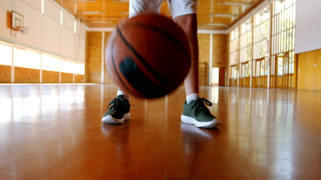 Portrait of schoolboy holding basketball in basketball court video