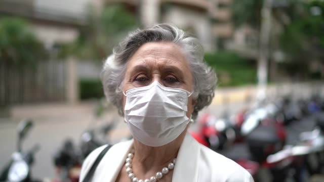 portrait of senior businesswoman with mask - mask стоковые видео и кадры b-roll