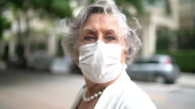Portrait of senior businesswoman with mask video