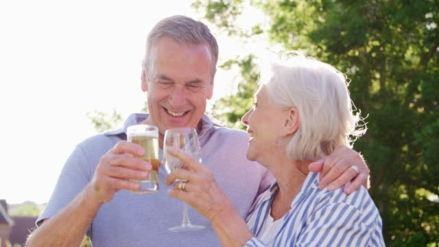 Portrait Of Senior Couple Enjoying Outdoor Summer Drink At Pub video