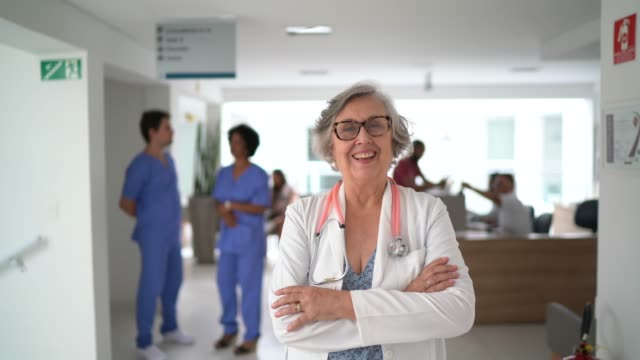 Portrait of senior female doctor at hospital Portrait of senior female doctor at hospital cardiologist stock videos & royalty-free footage