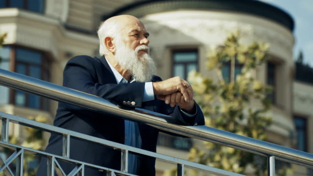 Portrait of senior man enjoys a city life from observation deck video