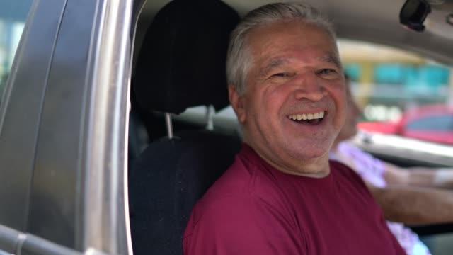 Portrait of senior man inside a car Portrait of senior man inside a car car rental stock videos & royalty-free footage