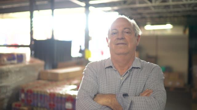 Portrait of senior warehouse worker